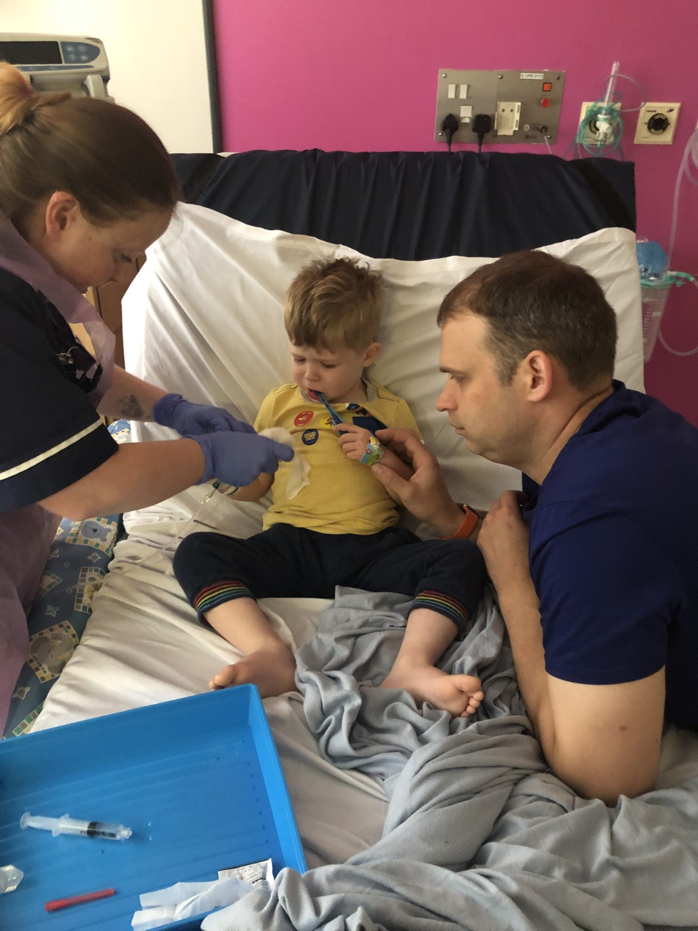 Artie, 3 years old having his fluids fitted to his newly fitted and very uncomfortable cannula.